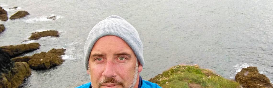 Headshot of Adrian Vaugha